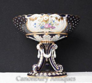 Urna in porcellana singola su basamento in zuppiera floreale