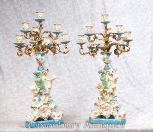 Accoppia candele candelabri in porcellana Cherubino francese di Sèvres