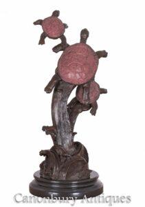 Trio di tartarughe di bronzo sulla tartaruga statua di ramo